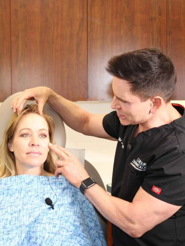 Timothy Jochen, MD and Ginger Jeffries discuss placement of facial filler at Day of Beauty.